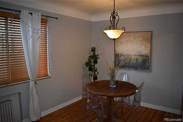 Photo #4 Dining Room directly adjacent to Living Room and Kitchen