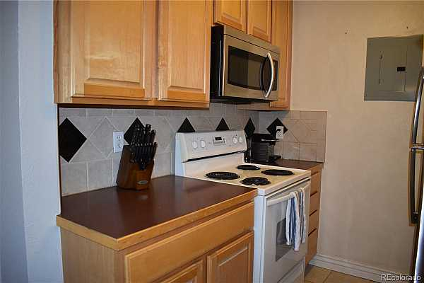 Photo #6 Kitchen with New Stainless Microwave and Refrigerator