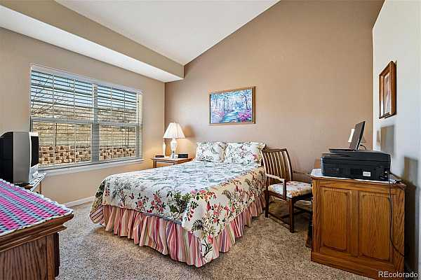 Photo #10 RARE MAIN FLOOR MASTER SUITE with soaring ceilings and large windows overlooking great view