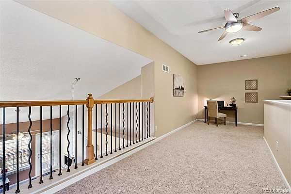 Photo #14 WOW!! Fantastic upper loft is perfect for a home office or great Flex Space...Note the custom iron railing and designer ceiling fan