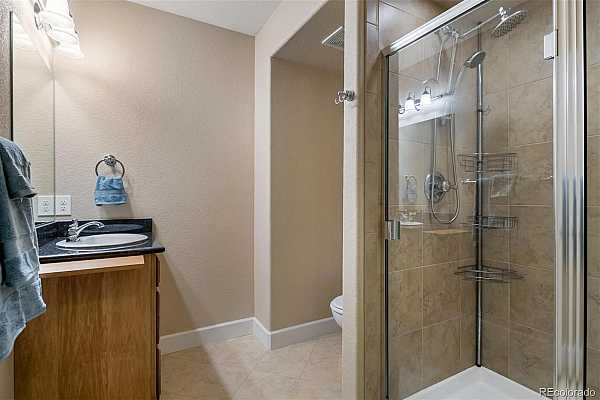 Photo #16 Updated bathroom with more granite countertops and neutral decor