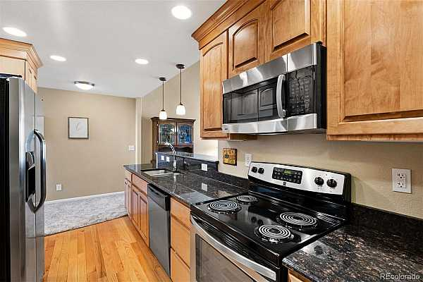 Photo #4 Beautiful quality remodeling with granite counters in kitchen along with quality maple cabinetry with cinnamon glaze finish.
