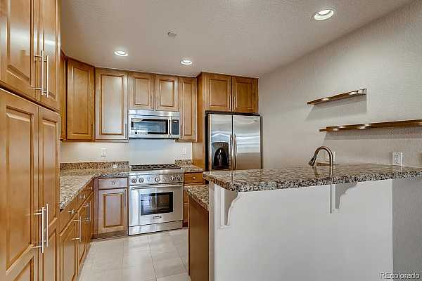 Photo #17 Fabulous kitchen with roll out shelving, gas range, all appliances included.