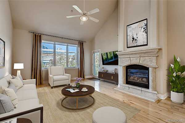 Photo #2 Living room with lovely hickory floors, and a stone faced gas fireplace as your focal point.