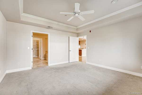 Photo #22 Main floor owner or Masterbedroom--coffered, or tray ceiling and ceiling fan.