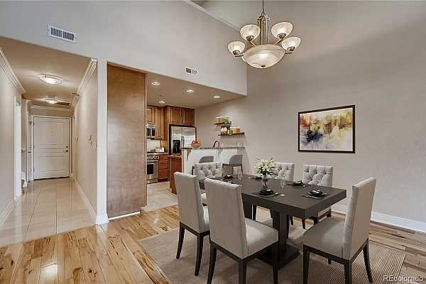 Photo #3 Dining area featuring hickory flooring, and easy serving adjoining the kitchen, entertaining is easy with living room adjacent as well.